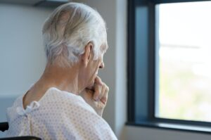 Thoughtful senior patient